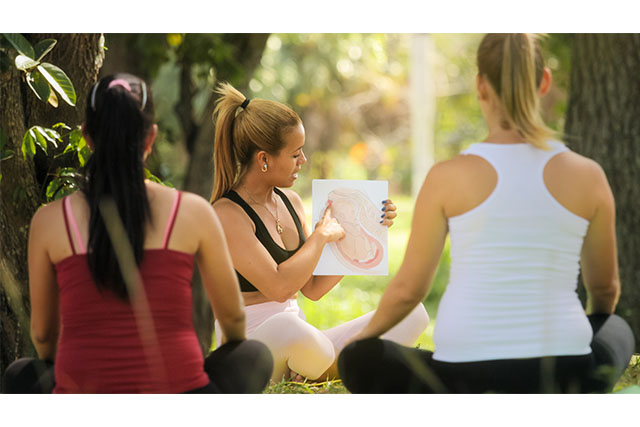 pregnant women at outdoors lamaze class