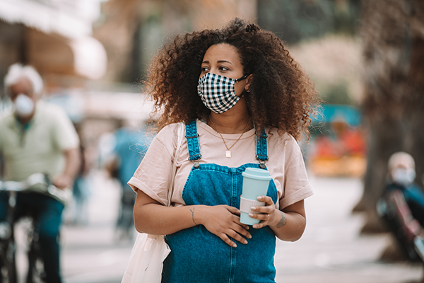 Pregnant woman with mask on in public